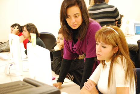 Daniella Nevarez, student employee for Instructional Support Services at UTEP, assists student Alexandra Arras.