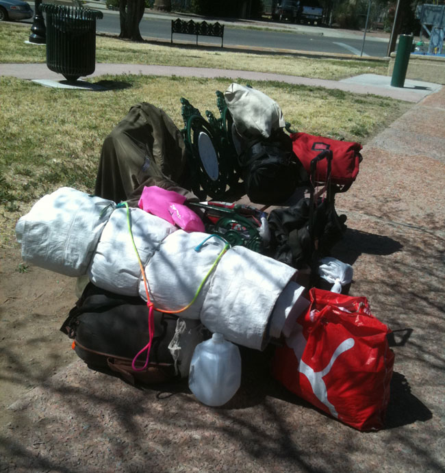 A homeless' belongings set on a park bench at Sunset Heights, El Paso. (Lourdes Cueva Chacón/Borderzine.com)