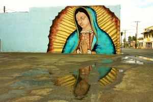 Reflection of the Virgin. The mural of the Virgin of Guadalupe is located next to a gas station in the Lower Valley of El Paso. (Cynthia Carol Almodovar/Borderzine.com)