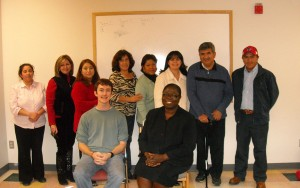 Chris Jolley and co-teacher, Ms. Olifemi, with their students at Irving Schwartz Public Library citizenship class, fall 2009. (Courtesy of Chris Jolley)class