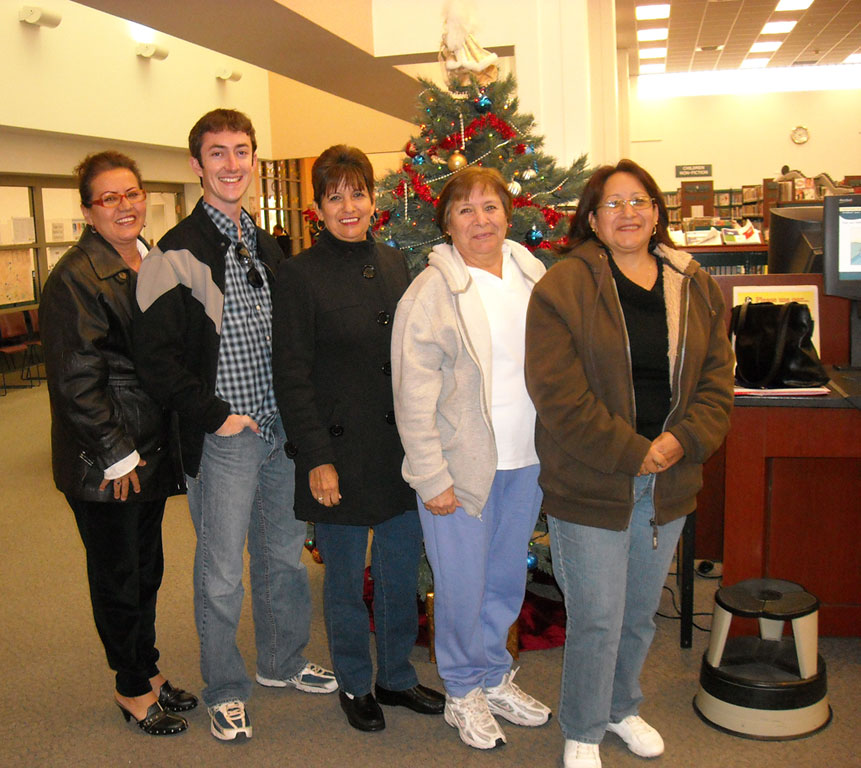Chris Jolley, 23, and four of his students at the Ysleta Public Library citizenship classes, fall 2009. (Courtesy of Chris Jolley)