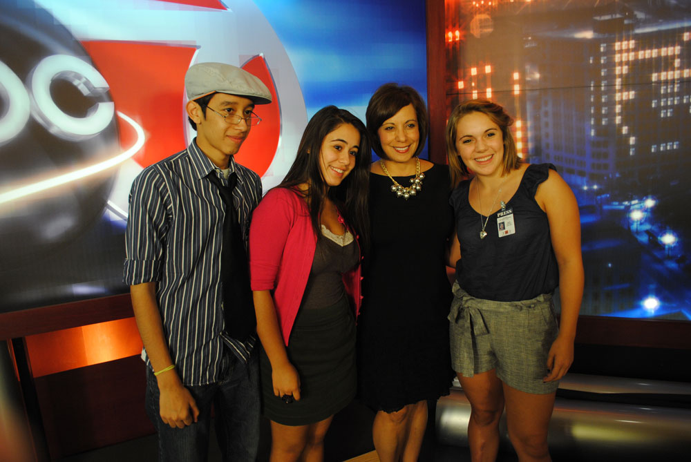 Journalism in July participants, Andy Martinez, Stephanie Avalos and Sarah Skirmont surround KVIA anchor, Estela Casas. (Omar Perez/Borderzine.com)