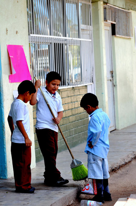 Kids are in charge of sweeping and mopping the classroom. (George Thomson)