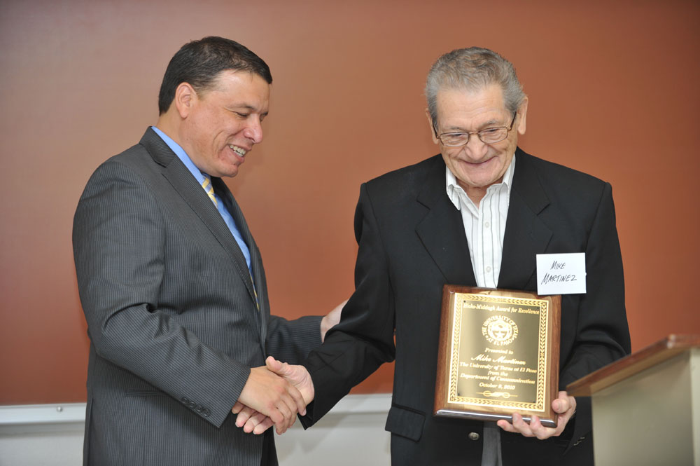 Mike Martinez receives the 2010 Hicks-Middagh Award for Outstanding Alumni in the field of Communication from Dr. Frank Pérez. (Brian Kanof/Courtesy of the UTEP Dept. of Communication)