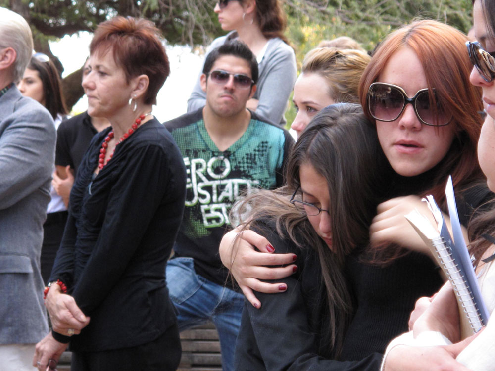 Classmates of Manuel Acosta and Eder Diaz mourn their deaths at a memorial organized by UTEP officials. (Danya Hernandez/Borderzine.com)