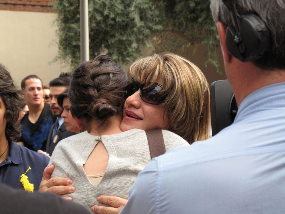 Guadalupe Acosta receives condolences from people present at the memorial. (Danya Hernandez/Borderzine.com)