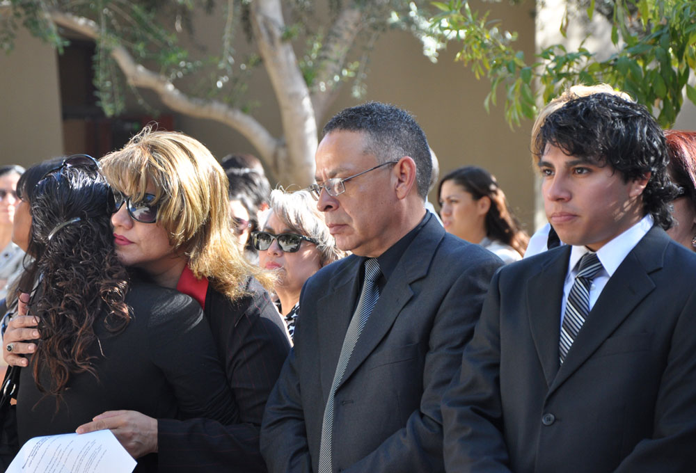 Manuel Acosta's family members mourn his death at a memorial organized by UTEP officials. (Salvador Guerrero/Borderzine.com)