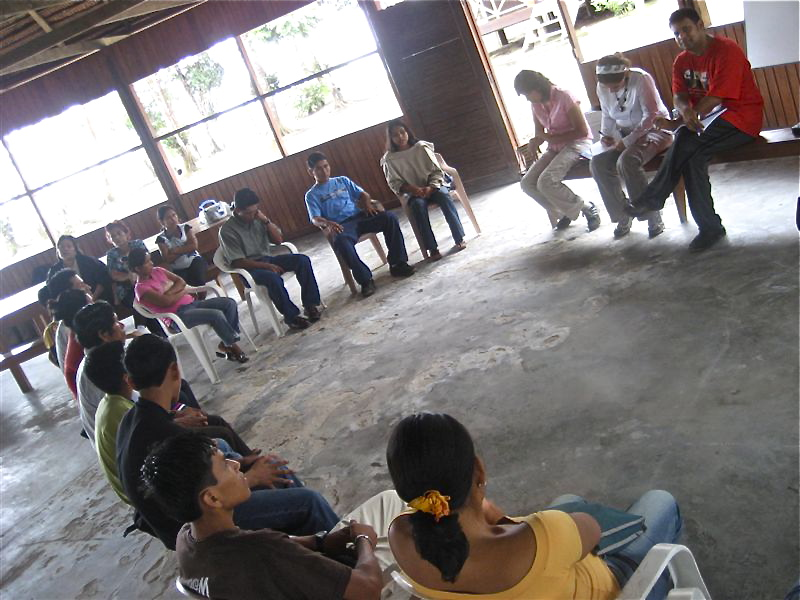 Lucia Dura and Arvind Singhal (far right) conducting a focus group in an Amazonian village. (Courtesy of Lucia Dura)