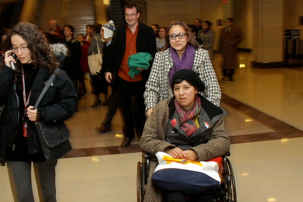 Lucinda Martinez, in the wheelchair, and Pamela Resendis are emotional as they leave the House chamber Wednesday after the House passed the Dream Act. Martinez fasted for 30 days to show support for the bill. (Raymundo Aguirre/SHFWire)