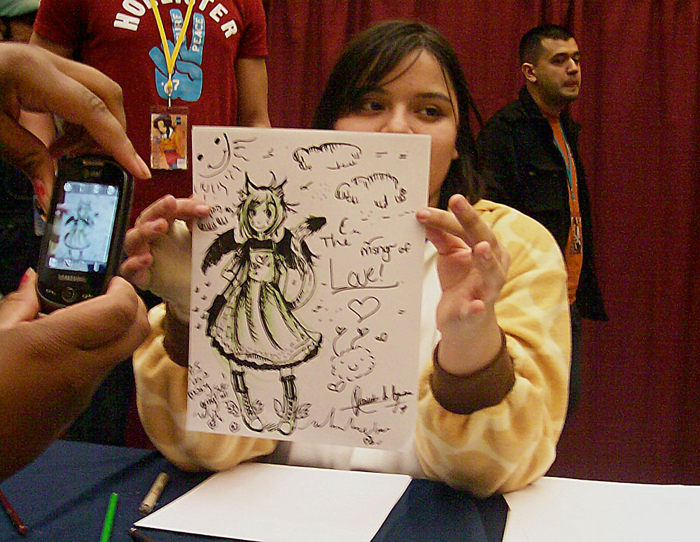 Danielle A. Aguirre shows off her second place winning drawing during Las Cruces Anime Days 2011's Iron Artist competition. (Photo courtesy of Alicia Nicole Bracken)