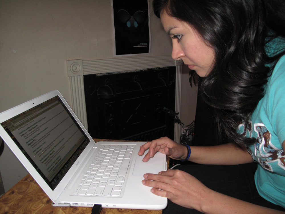 Elizabeth Estrada, December 2010 graduate, Bachelors in Organizational and Corporate Communication, looks for a job on UTEP's Jobmine website.