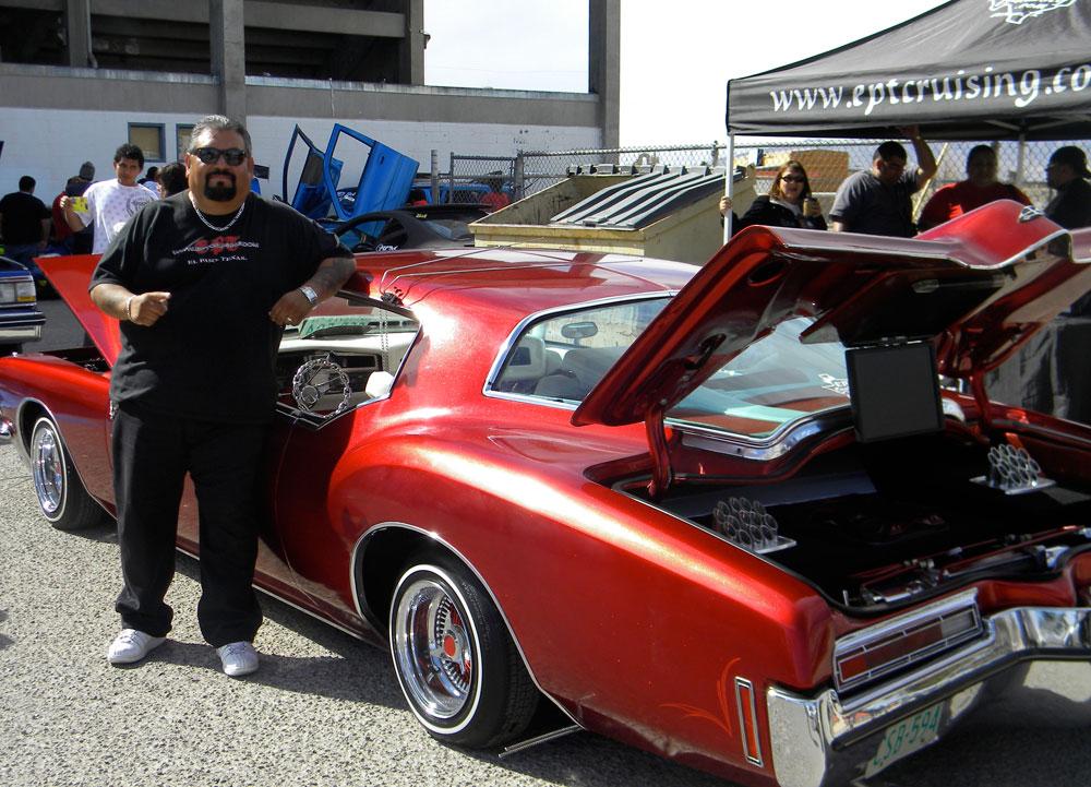 A member of EPT Cruising proudly shows his car. (Georgia Rodriguez/Borderzine.com)