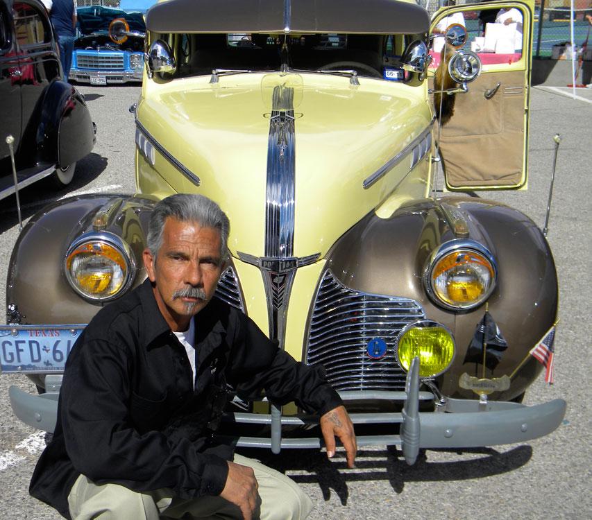 Larry Primera and 1940 Pontiac Silver Streak from the Our Story Car Club. (Georgia Rodriguez/Borderzine.com)