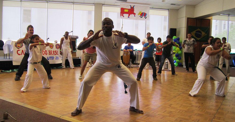 Members of Capoeira Quinto Sol give a lesson to the Brazilian festival attendees. (Adriana Macias/Borderzine.com)