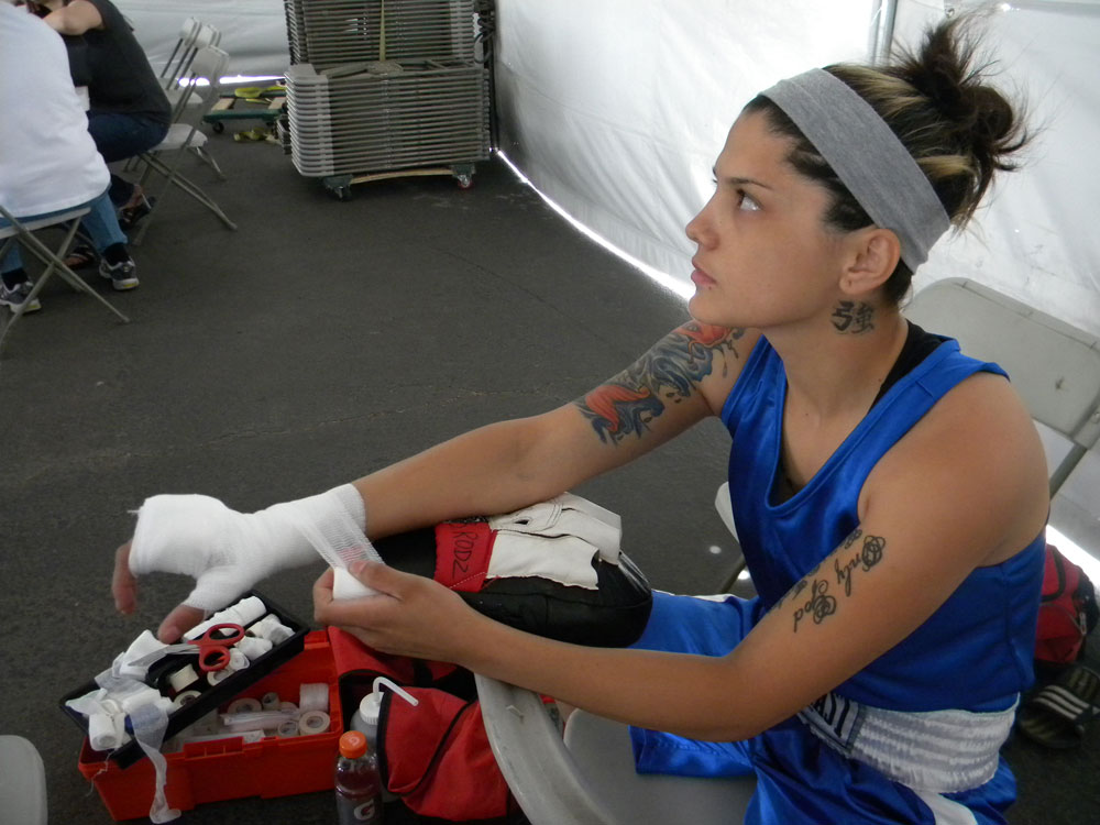 Rodriguez prepares before her fight. (Georgia Rodriguez/Borderzine.com)