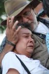 Javier Sicilia comforts Luz María Dávila at the really in Juarez on June 10. Dávila had two sons killed in Villas de Salvacar. (Luis P. Hernández/Borderzine.com))