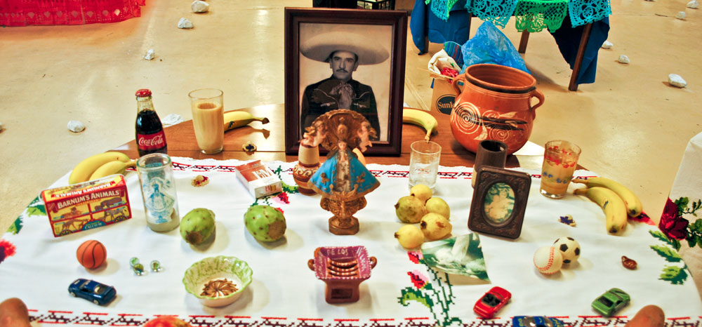 Lorena Andrade's altar in memory of her father and nephew. (Elvia Navarrete/Borderzine.com)