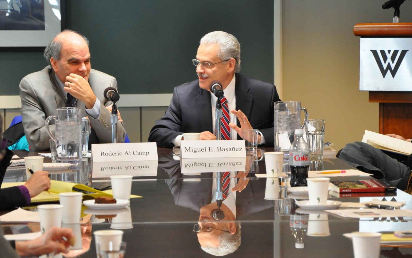 Roderic Ai Camp, left, and Miguel E. Basáñez talk about Camp's recent books about politics in Mexico. (Salvador Guerrero/SHFWire)
