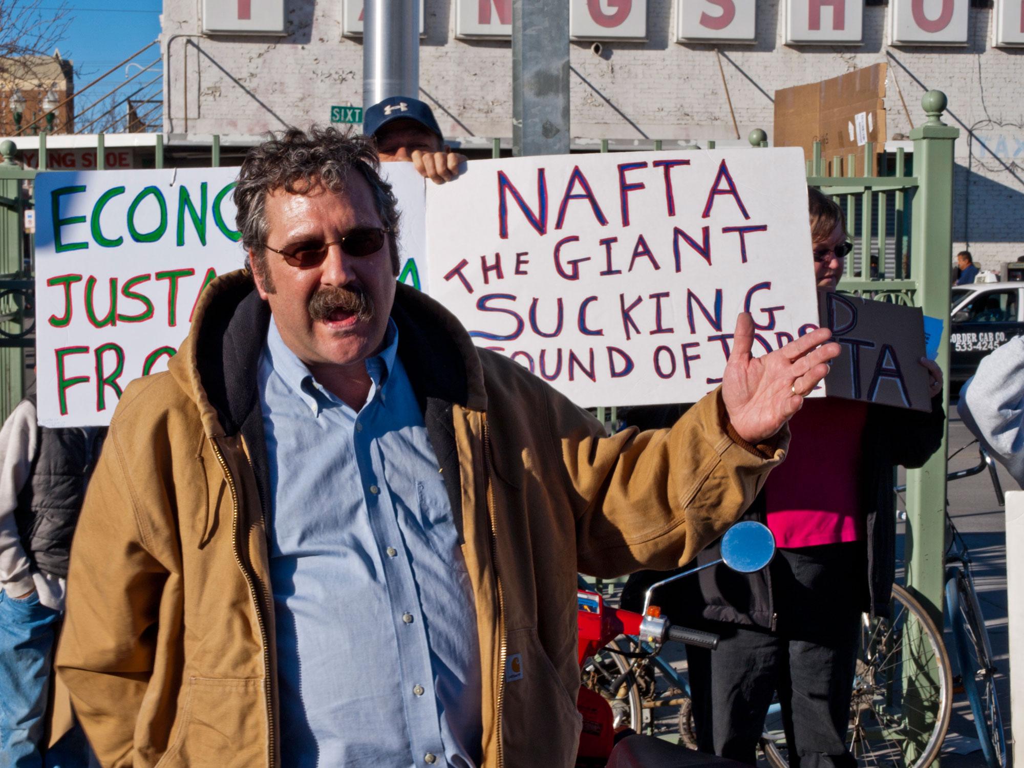 Dr. Joe Heyman, a volunteer with Occupy El Paso and a Professor at UTEP, speaks at Santa Fe bridge. (Robert Brown/Borderzine.com)