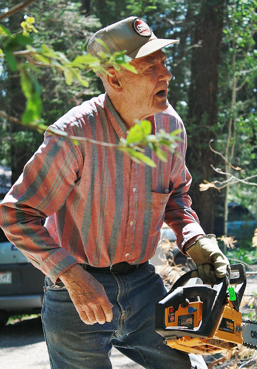 Louie Long, of Cloudcroft,  WORKING on cutting down a dead tree. (Cheryl Howard/Borderzine.com)