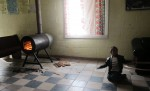 The TV room has a wood-burning stove. (Idali Cruz/Borderzine.com)