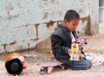 One of the children from the shelter plays outside. (Idali Cruz/Borderzine.com)