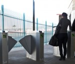 After paying at the new tolls, pedestrians get a card that allows them to go through the turning stalls. (Guerrero Garcia/Borderzine.com)