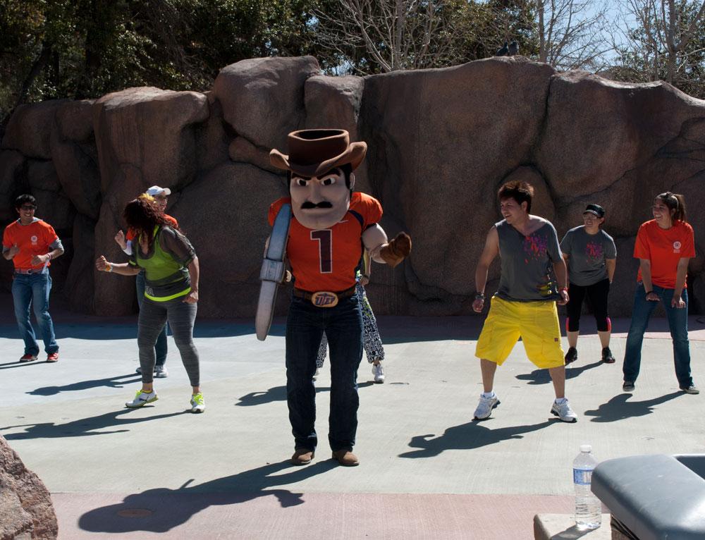 Zumba instructors and UTEP mascot, Paydirt Pete, entice people into healthy exercising. (Cassandra Morrill/Borderzine.com)