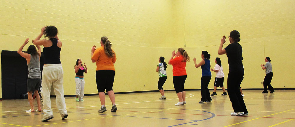 Men are not an strange presence in Zumba classes any longer. (Victoria Perez/Borderzine.com)