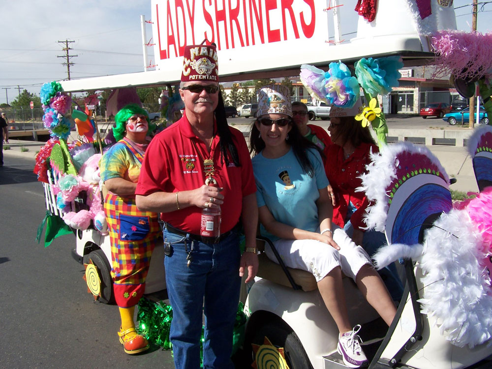 El Maida Shrine Potentate, Steve Miller, poses with Lady Shriners. (Courtesy of Ron Smith)