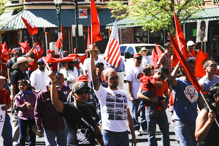 Erasmo and Sally at 2011 Cesar Chavez March, El Paso. Erasmo is behind the U.S. flag and Sally is just to the right. (Raymundo Aguirre/Borderzine.com)