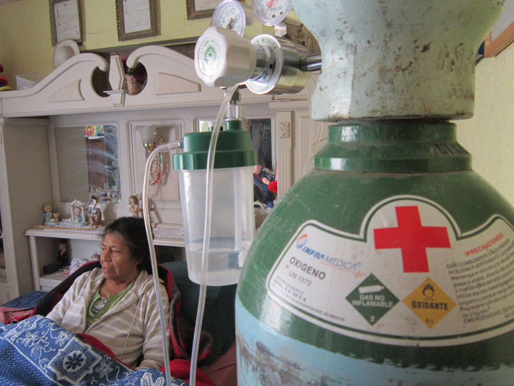 Guadalupe Vargas, 62, a diabetes patient, lives her life in bed. (Idalí Cruz/Borderzine.com)