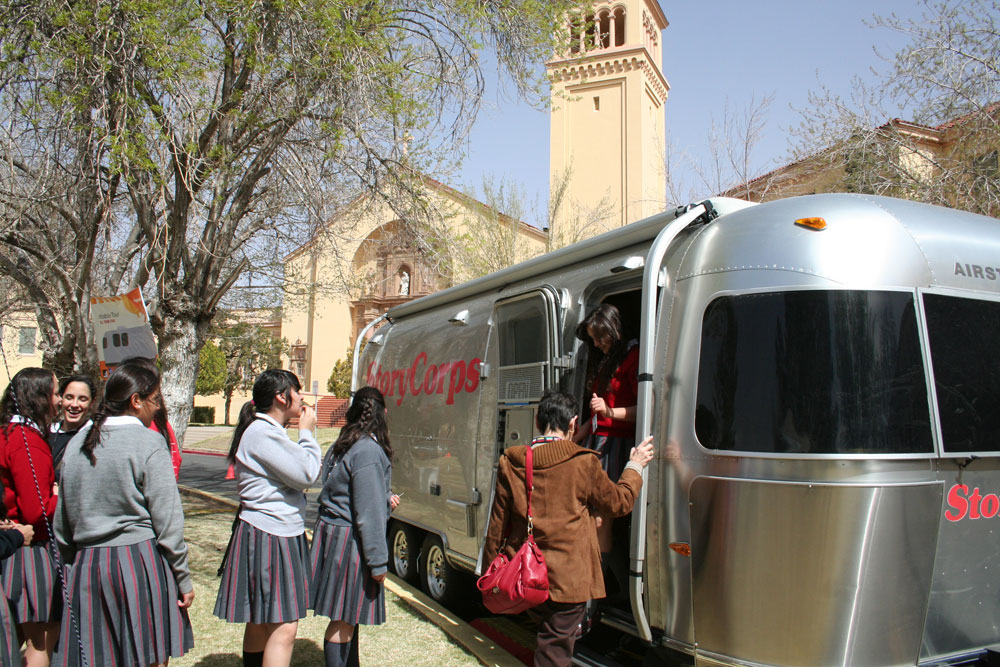 Students from the all-girls academy wait in line to get a glimpse of the inside of StoryCorps' recording trailer.(Amanda Duran/Borderzine.com)