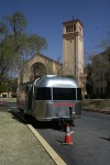 The shiny airstream trailer that has made its way across the country is parked in front of Loretto Acadamy's chapel. (Amanda Duran/Borderzine.com)