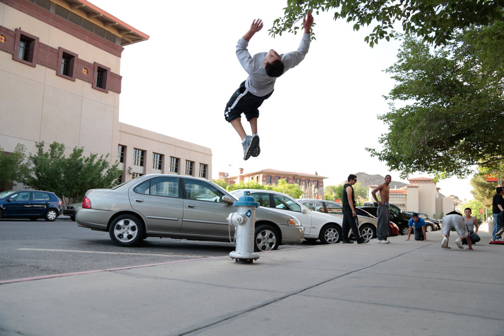 Angel Flores doing a backflip off a fire hydrant. (Ezra Rodriguez/Borderzine.com)