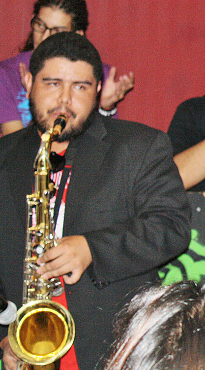 Richie David Marrufo, UTEP alumnus, PLAYING his saxophone. (Cheryl Howard/Borderzine.com)