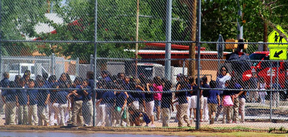 The children (little eagles, I presume) are in a semi-line and wearing school uniforms. (Cheryl Howard/Borderzine.com)