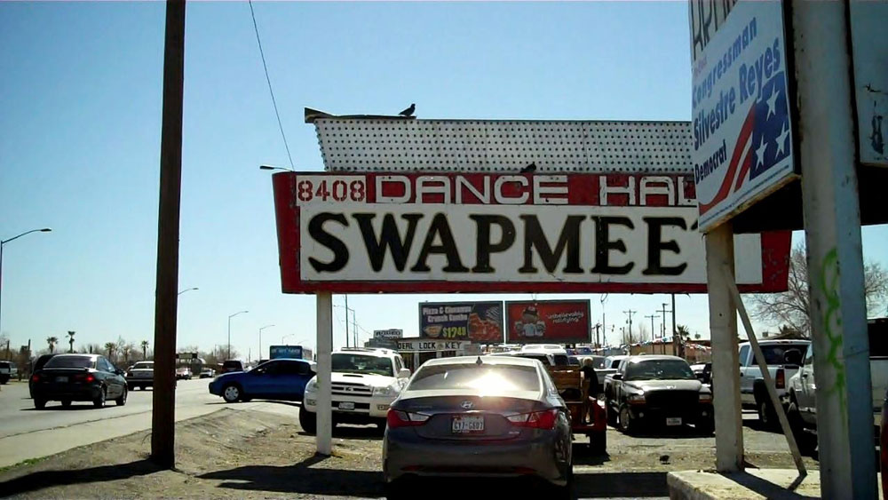 The Dance Hall/Swap meet sign sits in the front parking lot of the property. (Amanda Duran/Borderzine.com)
