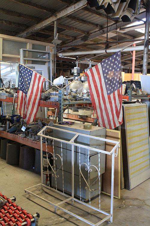 Flag display at McKinney Wrecking. (Cheryl Howard/Borderzine.com)