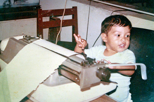 Family photo of Miguel Angel Lopez Solana, about 2 years old, sitting at the Telex machine in his father's office at Notiver. (©Miguel Angel Lopez Velasco)