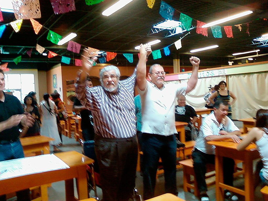 Reies Lopez Tijerina and José Ángel Gutiérrez at Mercado Mayapán celebrate 40 years of La Raza Unida. (Courtesy of Dennis Bixler- Marquez)