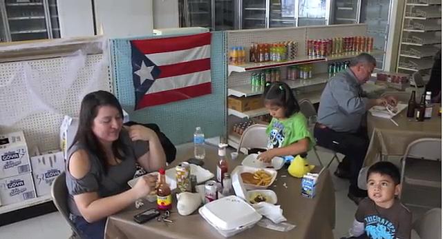Angelica Sanchez and her children enjoy Puerto Rican food at Maracas. (Meili Robles/Borderzine.com)