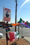 Mexican flags accompany pictures of victims. (Krystle Holguin/Borderzine.com)