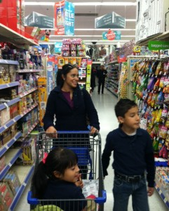 """Sassil Ayala uses the """"match your price"""" strategy to buy groceries and save money. (Selene Soria/Borderzine.com)"""