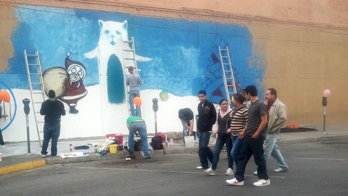 "The Urban Art-Fitters League of El Paso working on ""Winter wonderland"" at Fourth St. (Iris Lopez/Borderzine.com)"