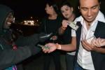 Members of the M Factor distribute condoms at Cincinnati district. (Michelle Blanks/Borderzine.com)