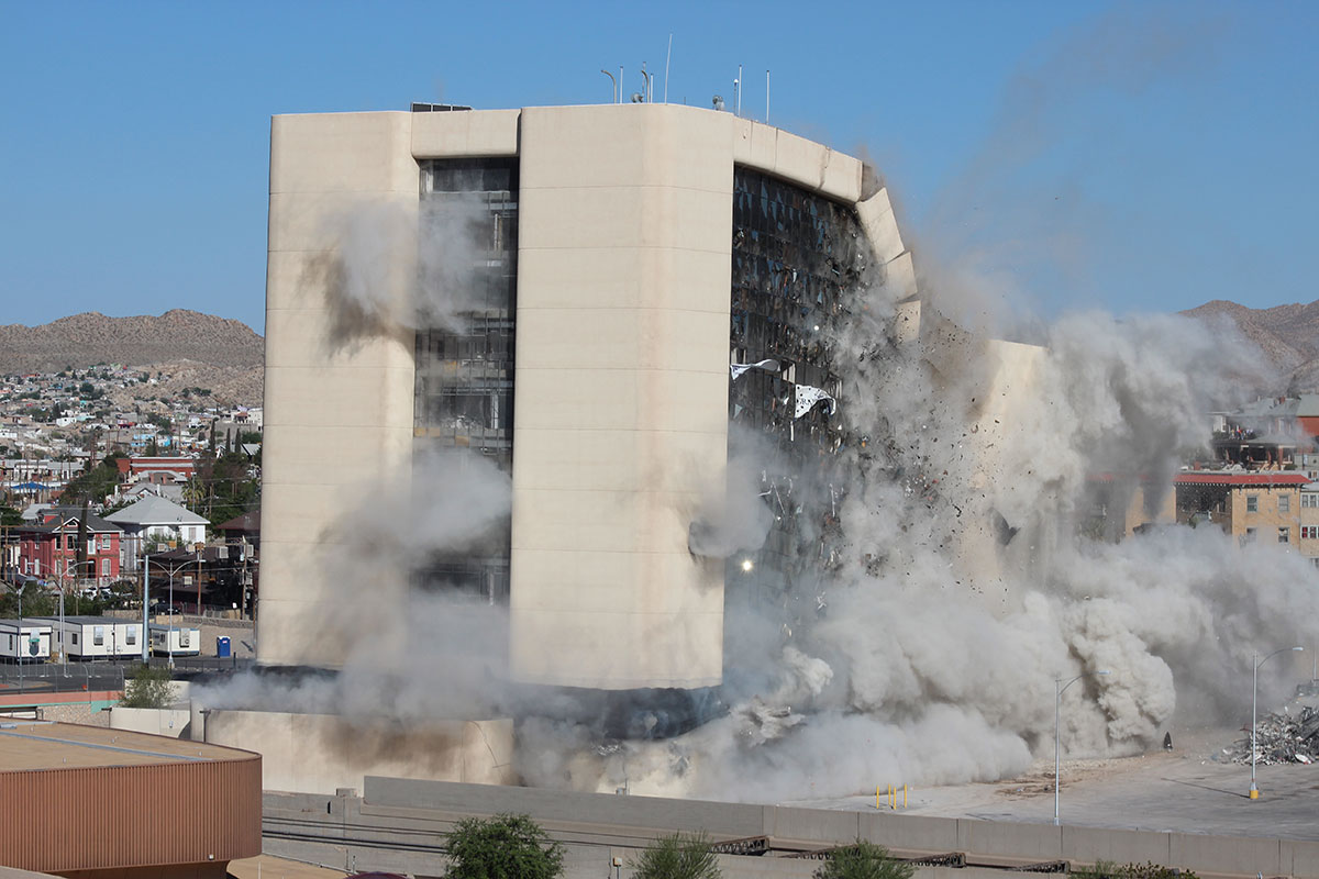 Immediately after the first explosions, (the building) still stood straight and tall as if defying those who wanted it to be gone. (Ken Hudnall/Borderzine.com)