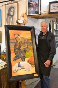 Manuel Alvarado with one of his art pieces at San Eli's art district. (Kimberly Garcia/Borderzine.com)