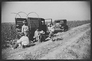 Mexican-American family parked near a cotton field in Mississippi during the 1920s. (Courtesy of Dr. Manuel Ramirez)