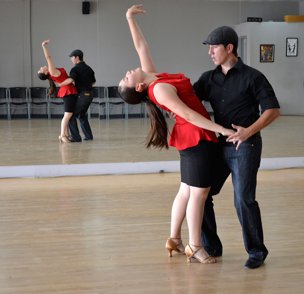 Instructor Stan Huber and student Alyssa Garcia at ballroom practice. (Kimberly Garcia/Borderzine.com)